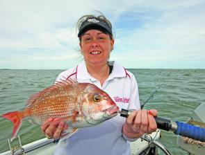 Angie Day displays a typical pinkie snapper that school up on the reefs.