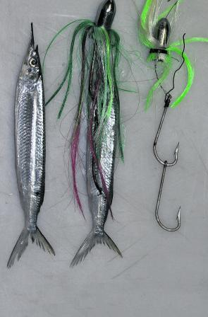 Garfish troll rigs are very simple and use a couple of gang hooks and a weighted bullet head. Using a small length of wire at the front hook is useful for tying around the gar beak to keep the bait straight. The added extra of a hairstyle skirt is also a