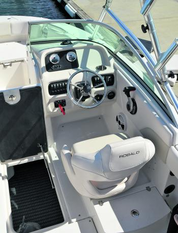 Beside the helm is massive underfloor storage. The helm itself has a broad array of switches and controls, but you may have to sacrifice a cup holder if you want to add a larger sonar screen.