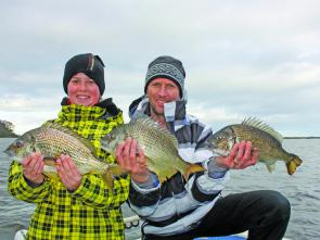 Cold, wet and windy conditions didn't stop Ian Lyons and son Brett, 12, from getting among the bream. These fish were released in great condition after the photo.