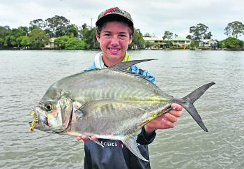 Bryce Francis from Davo's Tackle World caught and released this 64cm cale cale trevally at Tewantin.