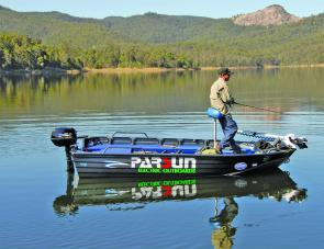 Ricky Simmons works the dam. The bow-mount runs on a single battery while the Parsun has its four 12v deep cycles.