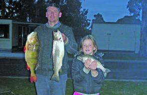 Peter Van Vledder and daughter Sophie with a nice rainbow, a 1.8 kg brown and a huge 2.2 kg redfin from Lake Fyans