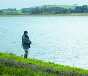 Shane Jeffrey fishes for redfin Newlyn Reservoir – this waterway will provide the best chance of catching a fish around Ballarat in January.
