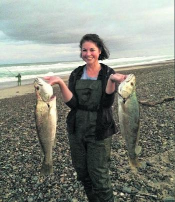 Local angler Janine Roberts with a brace of mulloway destined for the table.