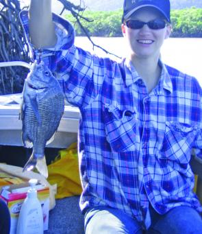 Claire with a nice black bream caught at Hinchinbrook.