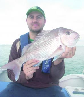 The author holds up a McLoughlins snapper of 57cm, which was caught inside in very shallow water.