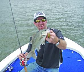 Chris Galligan shows that crankbaits fished around shallow bottom formations can produce quality bass.