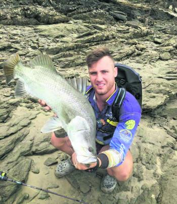 Trent shows off a solid Corio Bay barramundi on light gear.