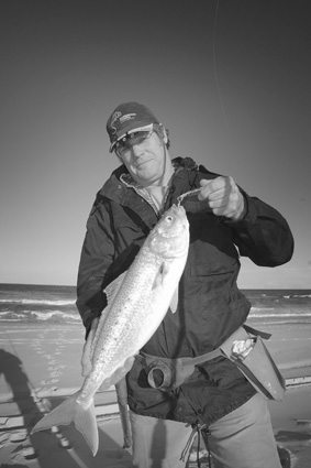 Dave Scarlett with the author's 3kg beach-spun salmon. Metal 65g Raiders are the perfect ammo for a beach assault.