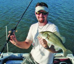 Chris Galligan with an average sized Moogerah bass taken on a paddle-tail plastic.