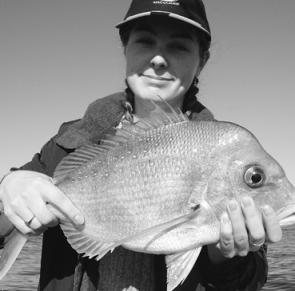 Clare Rashbrook with a snapper taken from the shallow ground at East Reef on a floating pilchard.