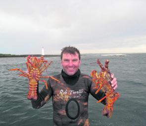 Rob Torelli and two fine west coast crayfish from Port Fairy