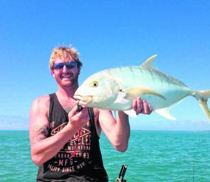 Large schools of baitfish will have plenty of predators, like this golden trevally, working close inshore this month.