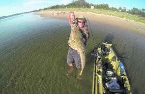 Dave Wells with another big flathead of 95cm, prior to release.