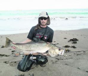 Ben Roberts with 12kg of plastic caught jewfish off the beach.