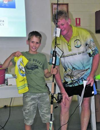 Wade Wessels presenting Elliot Ruddell from the Townsville Saltwater Sportsman Club with his ANSA Qld yellow champion angler buff and fish rod during the 2017 NQ Sportfishing Championships.