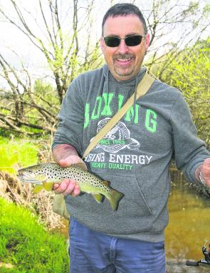 Wayne Love with a magnificent brown trout caught on a metallic bladed spinner in the tributary of the Kiewa River.