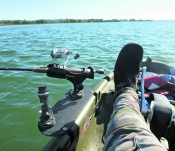 Ensure rod holders don't interfere with your paddle or pedal stroke.