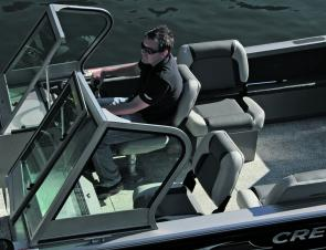 The high windscreen with folding walk-through provides ample cover while under way. Access to the bow is easy.