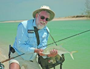 Ken Stein with a fiesty brassy trevally taken while flycasting off the beach on a beautiful late season Weipa morning.