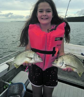 Paige Kelly with bream caught on surface lures on the sand flats at Blakesleys Anchorage.
