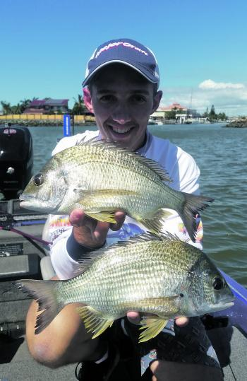 Jesse Gough holds up some good-sized Redcliffe Peninsula bream.