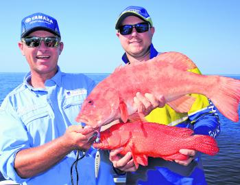 The author and Al McGlashin with a double hook-up on a nice trout and coral cod.