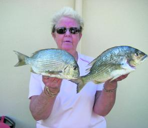 Lyn Martin with a 34cm bream and a 32cm tarwhine she picked up on Queenscliff Beach using peeled and diced king prawns on 5kg line.