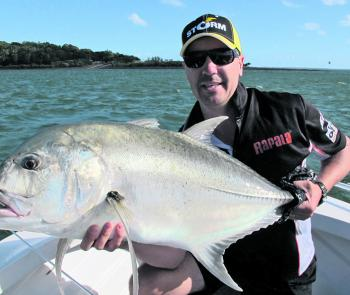 Livo with a 15kg river giant trevally caught in a hole, while the current was strong.