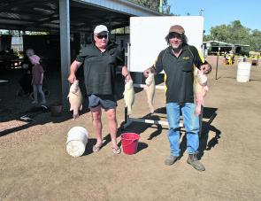 Wiz and Freddy show off their catch from the 2013 Isisford Comp.