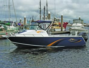 The Yellowfin 6700C on a busy Gladstone harbour. This ruggedly handsome boat is sure to appeal to hard-core fishos.
