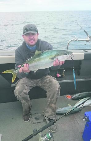 The author with a nice kingfish caught on a 200g knife jig.