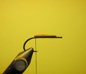 Attach the thread to the hook and tie in 2 sections of heavy lead wire side by side on top of the hook